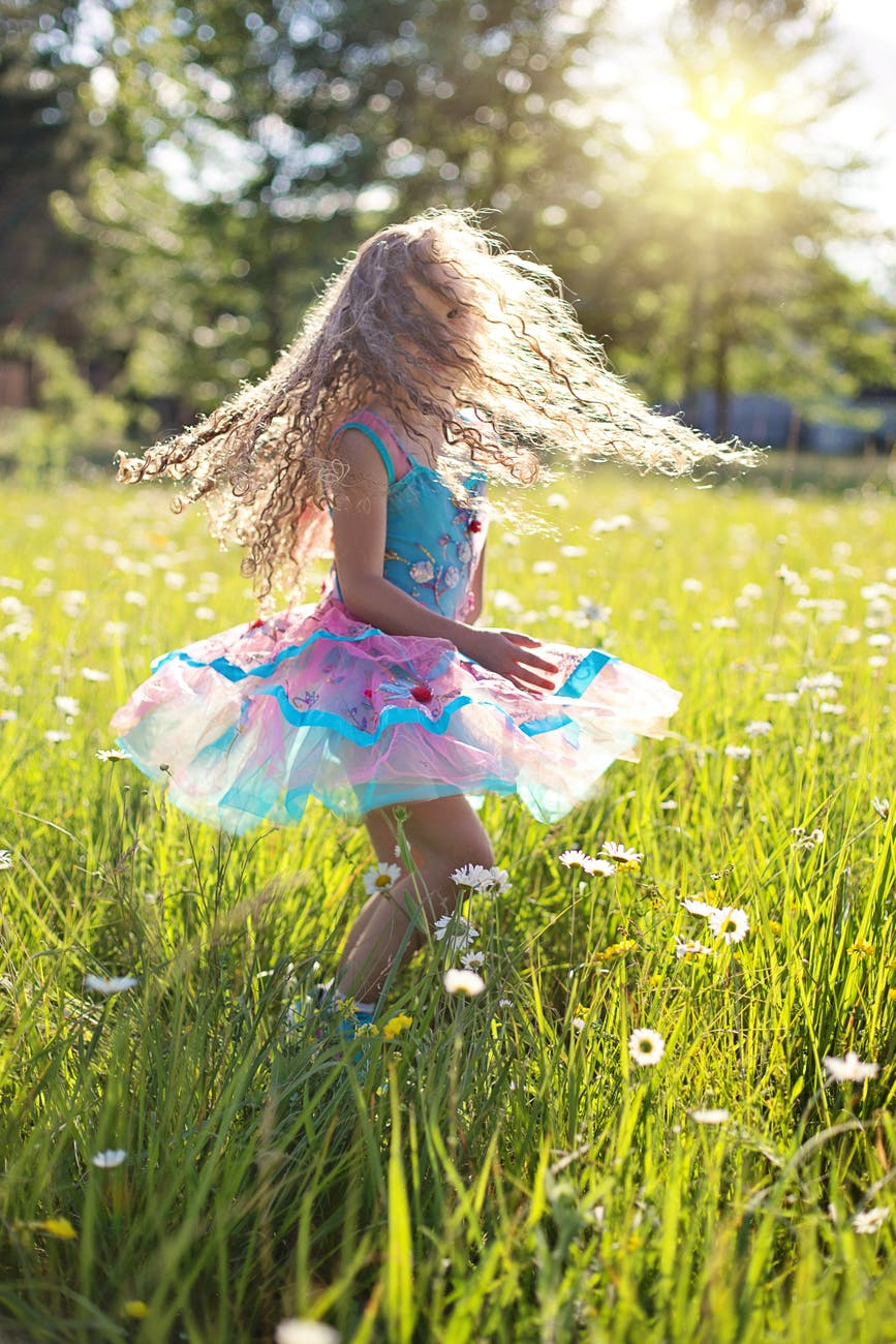 carefree cheerful child daisies