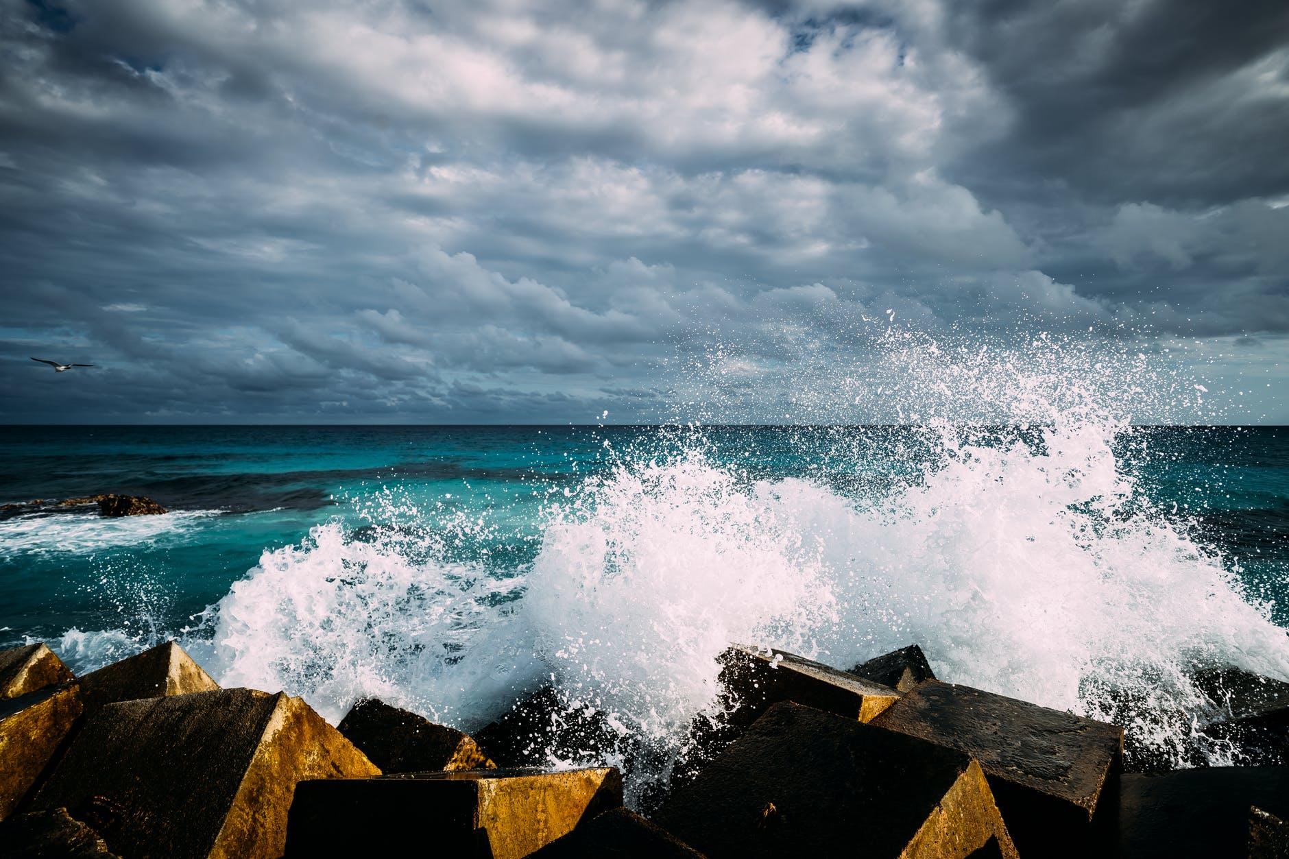 crash foam ocean rocks