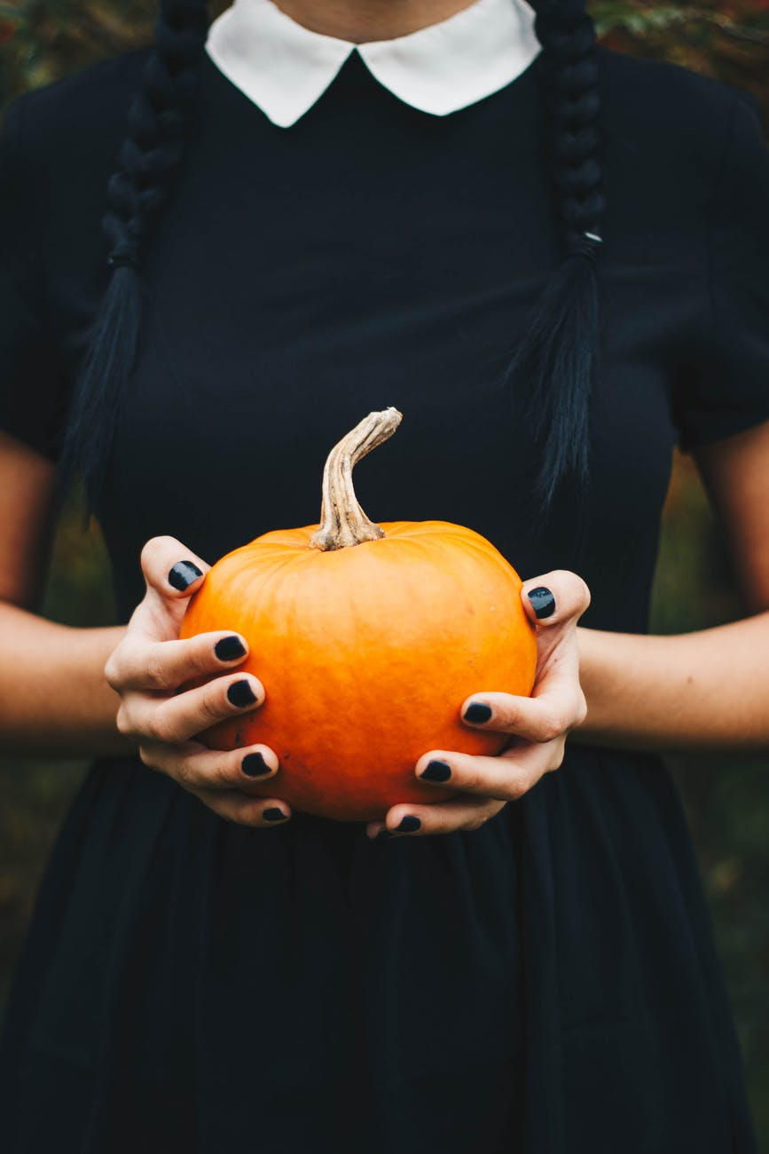 girl holding pumpkin