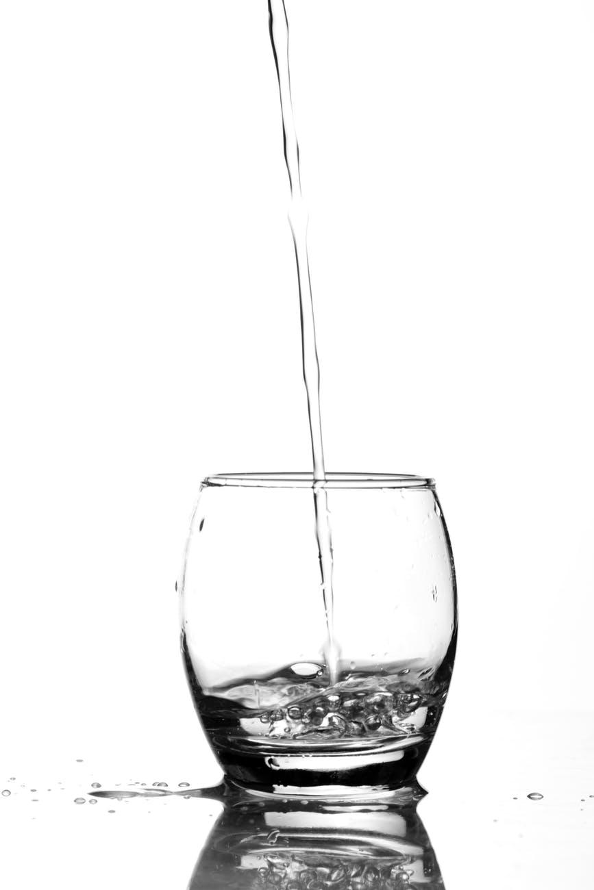 close up of water splashing in glass