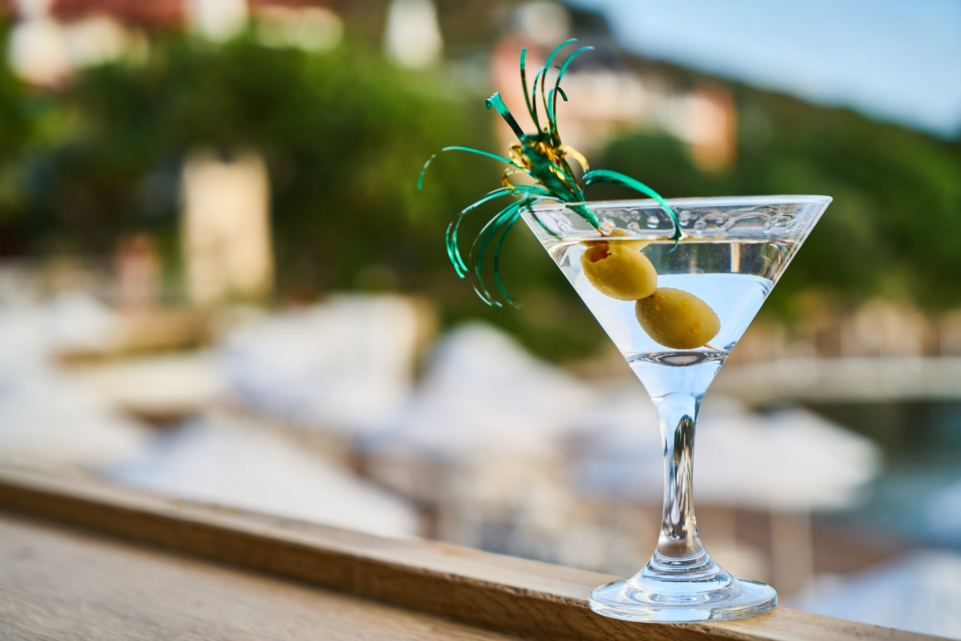 close up photo of martini with olives